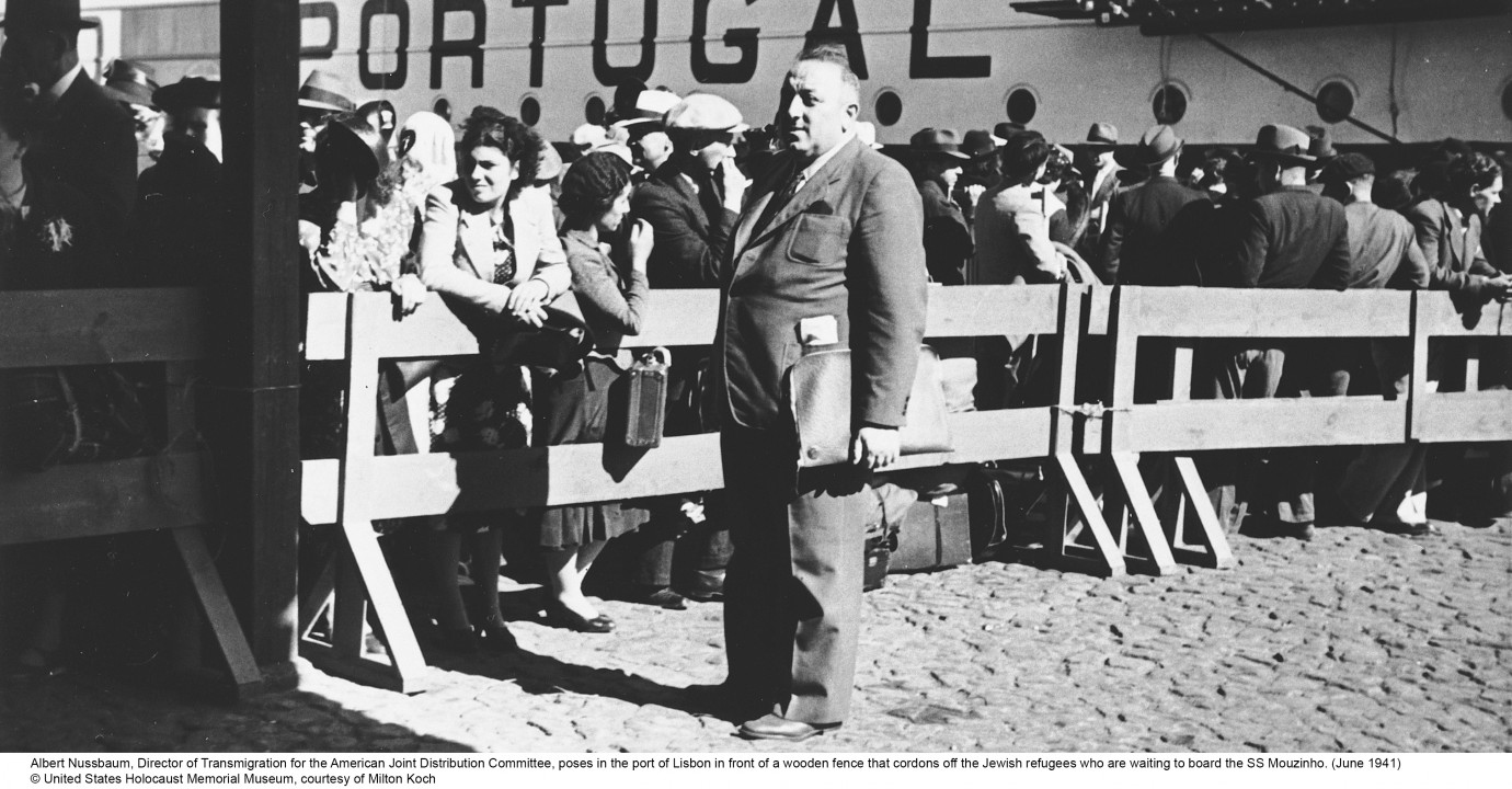Albert Nussbaum, Director of Transmigration for the Americain Joint Distribution Committee, with Jewish refugees in the port of Lisbon, June 1941 (© United States Holocaust Memorial, courtesy of Milton Koch)